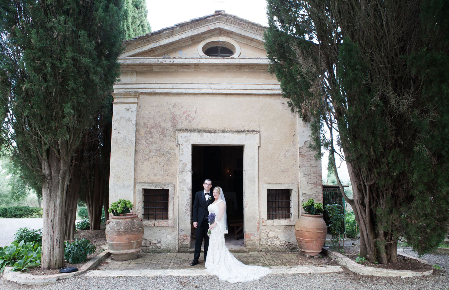 Bride and groom outside wedding chapel