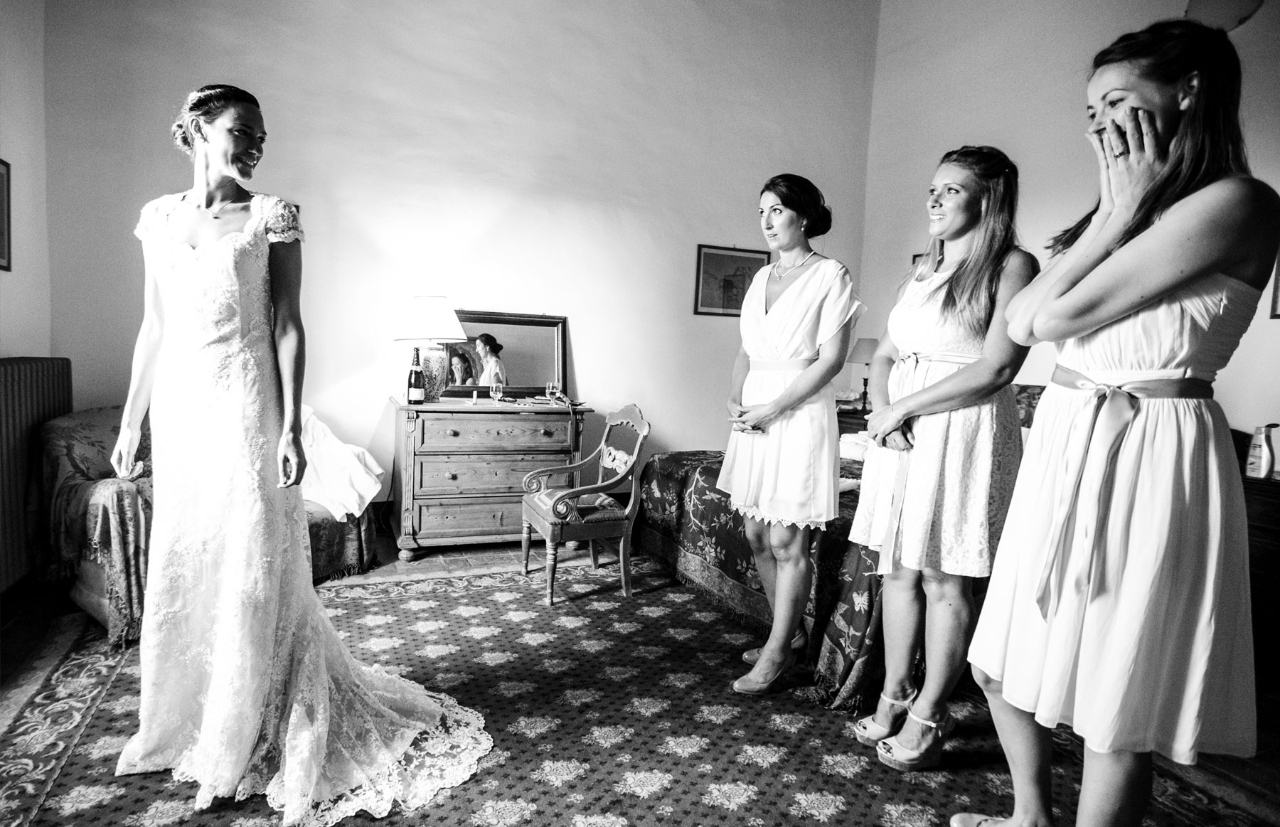 Black and white image of bride with attendants